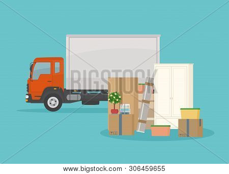 Moving Into New House. Delivery Truck, Furnitures And Cardboard Boxes. Isolated On Blue Background.