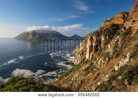 Rocky Cliffs On The Coastline Of The Atlantic Ocean Near Cape Town On Chapmans Peak Drive, South Afr