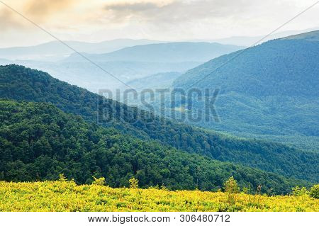 Green Mountain Background On A Cloudy Forenoon. Forested Hill Rolling In To The Distant Mountain Rid