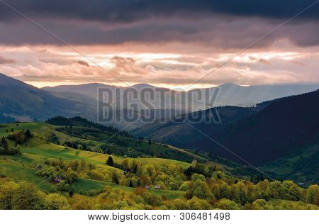 Mountain Rural Area In Springtime. Agricultural Fields On Hills With Forest. Beautiful And Vivid Cou