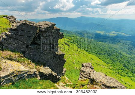 Huge Rocky Formations On The Grassy Hills. Beautiful Mountain Landscape In Late Summer On A Cloudy D
