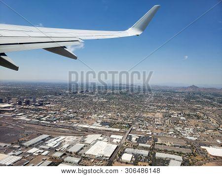 Bird Eye View Of City Of Phoenix From Airplane Climbing To Its Cruise Altitude, Arizona