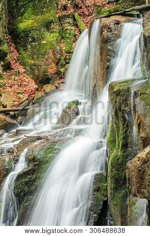Beautiful Forest Waterfall Scenery. Rapid Flow Down The Huge Boulders With Moss. Beautiful Nature Ba