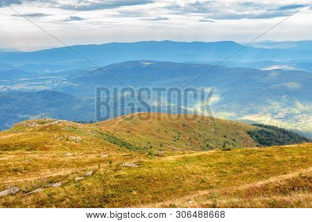 Hills And Meadows Of Carpathians In August. Beautiful Scenery On A Cloudy Day. Boulders Among The Gr