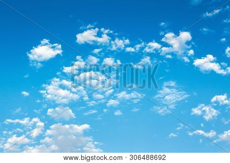 Beautiful Summer Sky Background. Lots Of White Fluffy Clouds On The Blue Sky. Vivid Nature Backgroun