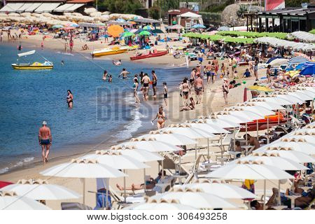 Procchio, Italy. June 28, 2016: Many People Swarm To The Longest Beach On The Island Of Elba In Ital
