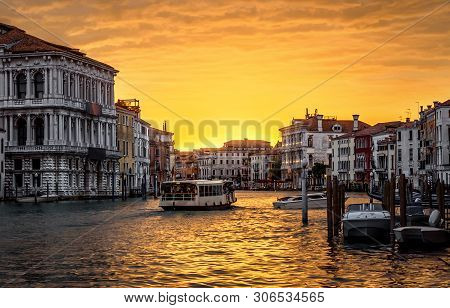 Venice Cityscape At Sunset, Italy. Panorama Of Grand Canal With Vaporetto In Evening. Urban Landscap