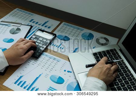 Businessman Using Laptop To The Situation On The Market Value , Business Concept.