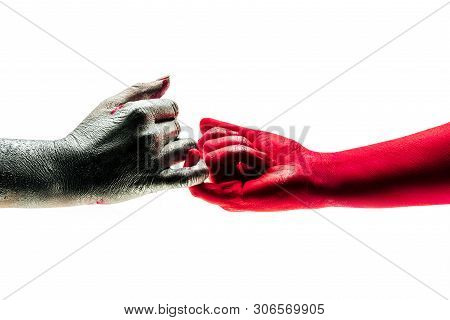 Different people came to firt peace after argument. Gentle and ceraful touch with little finger. Concept of little peace, of two people which came to reconciling. Symbolistic photo of war and peace. poster