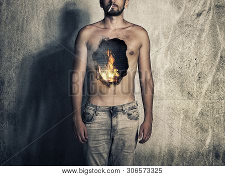 Hole On Fire In The Area Of the Lungs On Smoking Male.