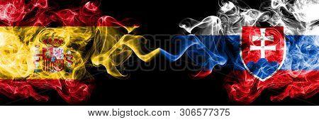 Spain Vs Slovakia, Slovakian Smoky Mystic Flags Placed Side By Side. Thick Colored Silky Smokes Flag