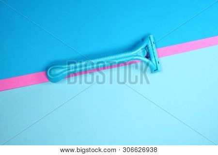 Prague, Czech Republic - May 20, 2019: Gillette Venus shaving razor for women, on a blue and pink surface