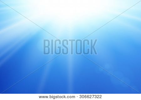 Blue Sky Sun Flare Background. Clear Summer Nature, Sunlight Weather. Sunshine Glare Rays, Lens. Lig