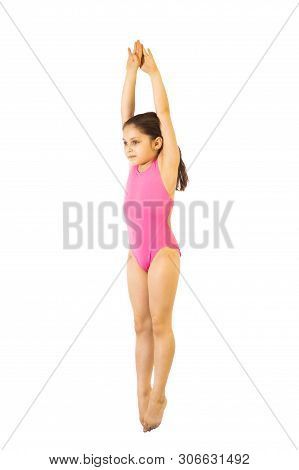 Diving. Little Caucasian Female 8 Years Old Diver Girl In Pink Swimmwear Jumping On White Background