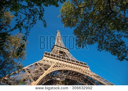 Eifel Tower Full Length Bottom Up Low Angle Shot From Tower Basement With Blue Sky Cloudy Background