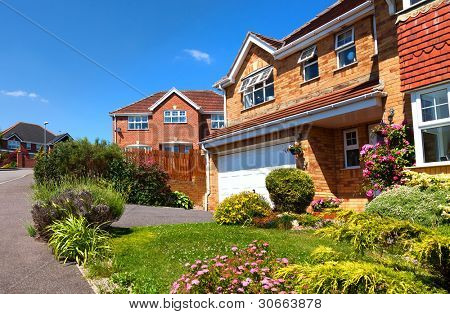 modern english brick house and garden