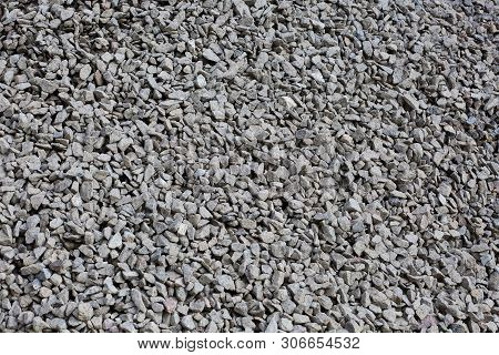 An even layer of grey building rubble poster