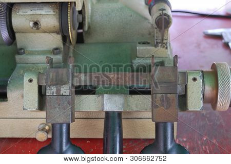 The Small Metal Handle Of The Metal Cutter Serves To Move The Metal Toward The Metal Cutting Blade.