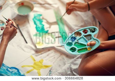 Artistic palette with tempera, close up