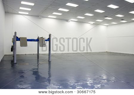 a single lift in car service garage with a blue floor (equipment for diagnostics of car)