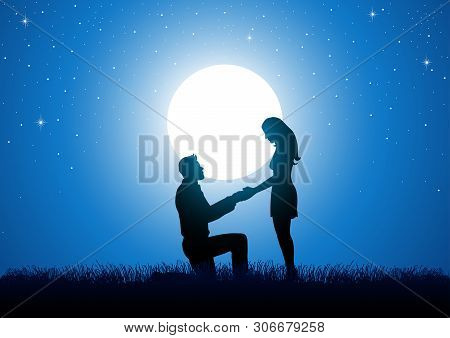 Silhouette Of A Man Kneeling Down And Holding The Hand Of A Standing Woman Against Beautiful Starry