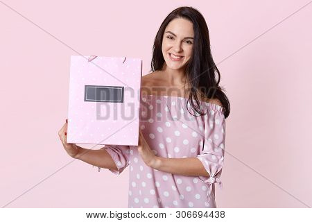 Happy Beautiful Young Woman In Polka Dot Dress, Holding Shopping Bags In Her Hands And Smiling Happi