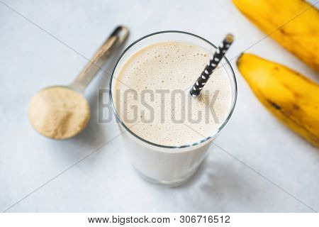 Vegan Protein Banana Shake Or Smoothie In Glass. Top View, Selective Focus
