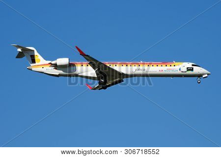 Iberia Regional Air Nostrum Bombardier Crj-900 Ec-jzu Passenger Plane Landing At Madrid Barajas Airp