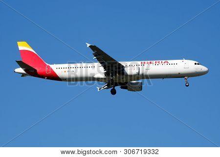 Iberia Airlines Airbus A321 Ec-jzm Passenger Plane Landing At Madrid Barajas Airport