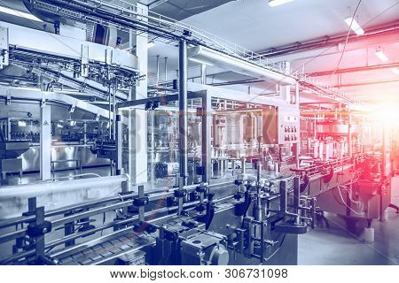 Industrial Factory Equipment In Blue Color With Red Light, Conveyor Line And Steel Tools, Industry B