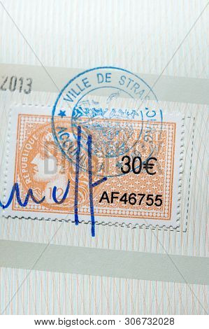 Paris, France - Apr 10, 2013: Macro Close-up Of Stamped And Signed French Revenue Stamp Timbre Fisca
