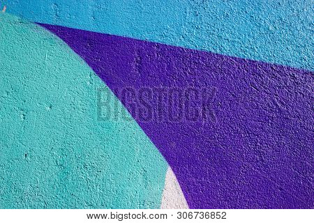 The Wall Is Painted With Bright Different Colors. Clear Contours And Bright Colors On A Plastered Wa