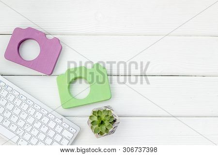 Blogger Table Design With Photo Camera, Keyboard And Plant On White Wooden Background Top View Mocku
