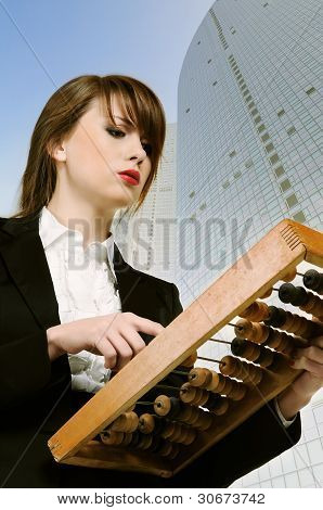 Young Attractive Businesswoman Holding Wooden Abacus.