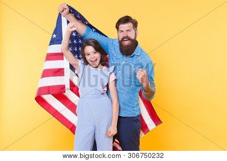 Getting In The Holiday Spirit. Father And Small Child Holding American Flag On National Holiday. Hap