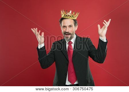 His Dream Of Being Champion Came True. Crowned Champion Smiling With Crown On Red Background. Happy