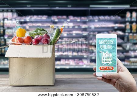 Online Order Grocery Shopping Concept On Touch Screen. Food Delivery Ingredients Service At Home For