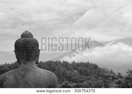Budha Statue Of Borobudur Temple With Background Of Sumbing Mountain