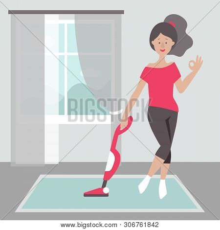 A Girl In A Red T-shirt And Black Breeches With A Vacuum Cleaner In The Living Room. Window Overlook