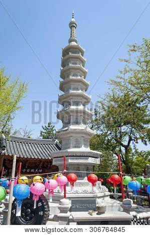 Busan, South Korea – April 2019: Stone Pagoda At Entrance To Haedong Yonggungsa Temple, A Buddhist T
