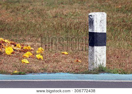 Concrete Kilometre Sign Pole On The Roadside With Nature Grass Background, Concrete Pillar Kilometer