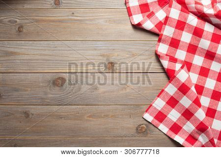 cloth napkin on at rustic wooden plank board table background, top view