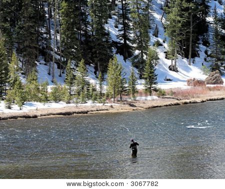 Fly Fisherman With Snow On Banks