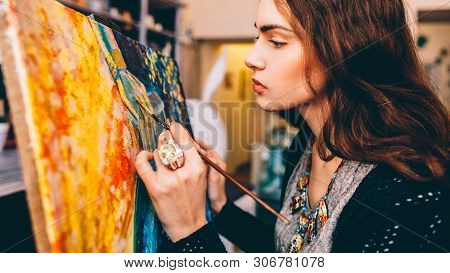 Art School Class. Side View Of Lefthanded Female Painter Creating Colorful Abstract Artwork In Studi