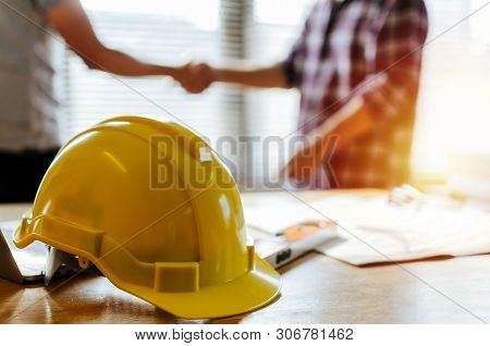 Construction Worker Team Hands Shaking Greeting Start Up Plan New Project Contract Behind Yellow Saf