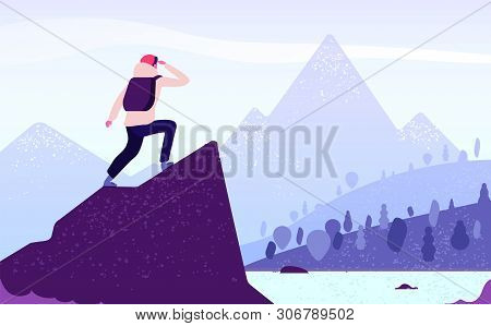 Man In Mountain Adventure. Climber Standing With Backpack On Rock Looks To Mountain Landscape. Touri