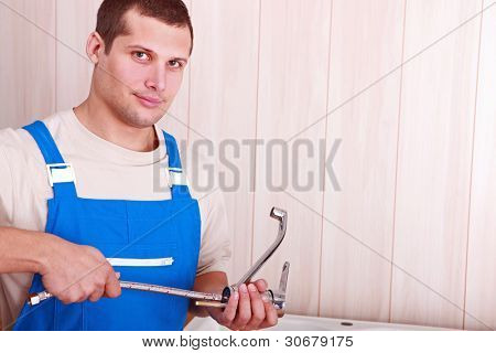 Plumber with faucet in hand