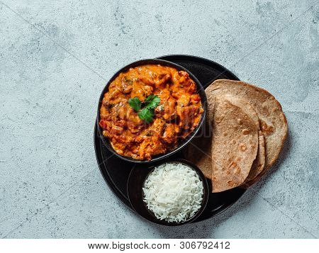 Indian Cuisine Dishes: Tikka Masala, Rice, Samosa, Chapati, . Indian Food On Gray Stone Background W