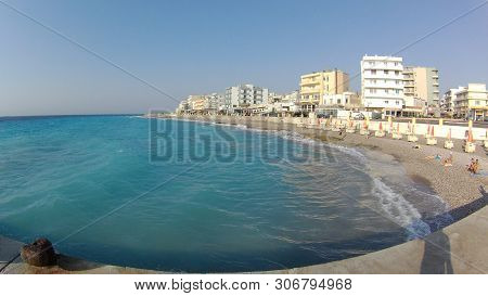 Rhodes: May 12, 2019 - Traditional Bulidings And Street Next To The Beach Of Rhodes Town On Rhodes I
