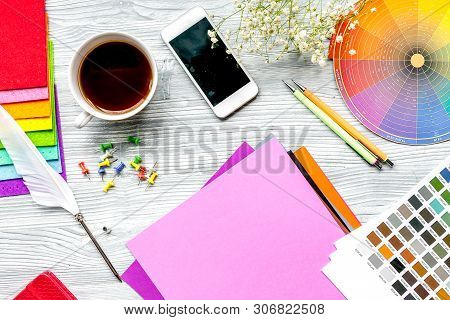 Professional Creative Graphic Designer Desk On Wooden Background Top View